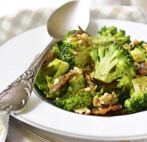 Broccoli bacon walnut salad tossed in dukkah butter