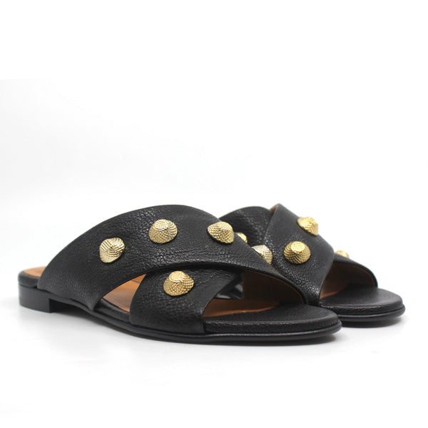 angle view pair of Black textured leather Billi Bi flat crossover slide with gold stud detail