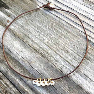 PUKA CHARMS LEATHER NECKLACE - PUKA CLOSURE