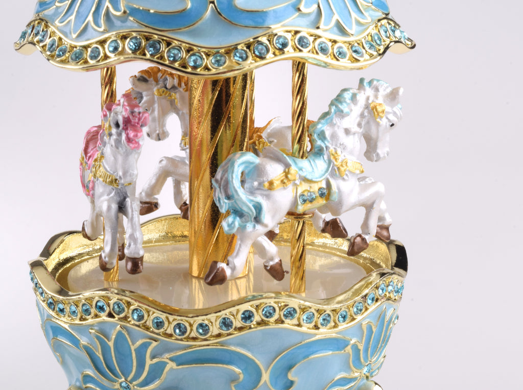 Keren Kopal Teal Wind up Musical Carousel  124.00