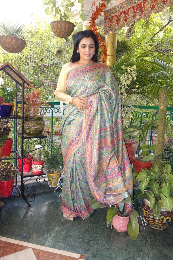 Mint green patola kani saree.