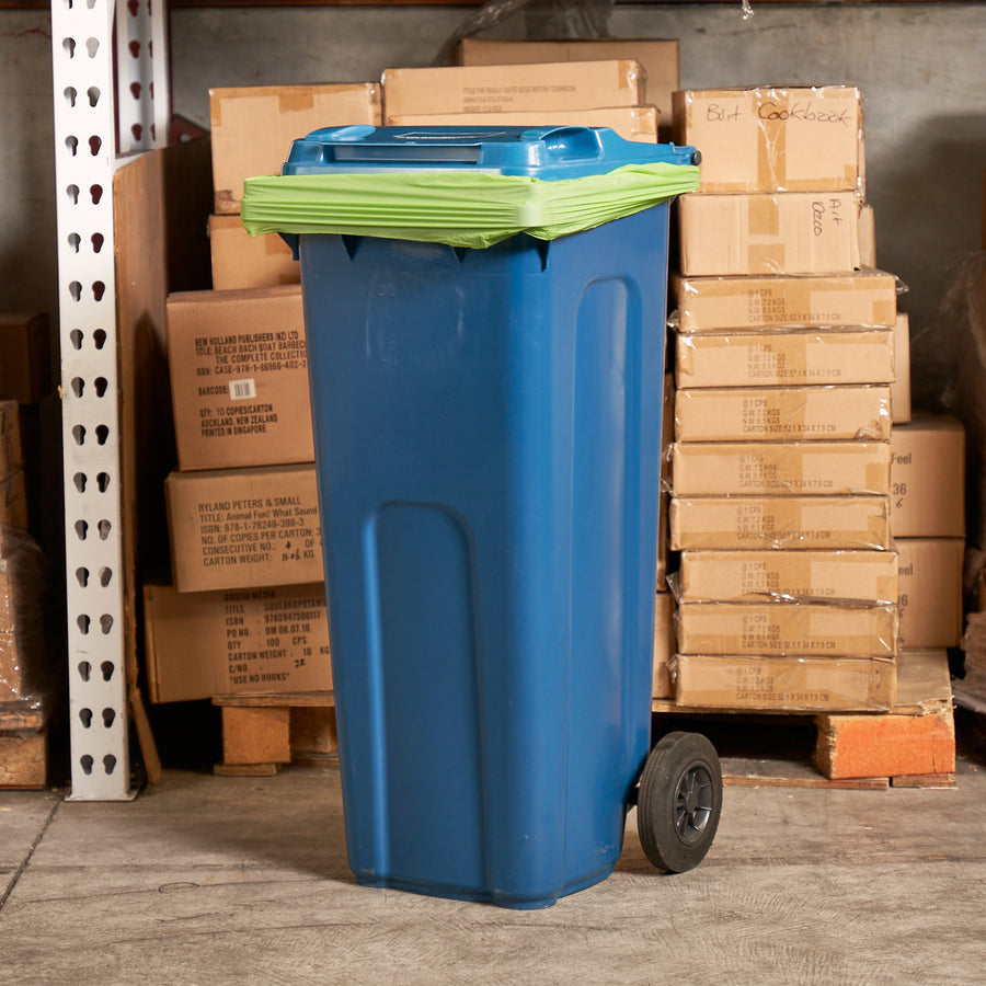 140L Compostable Bin Liner, great for lining your council wheelie bin. This picture shows a bin liner being used in a warehouse or business.