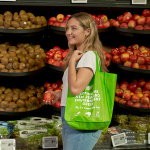 Compostable Re-Useable bag. Great for doing your shopping with as it's super durable and strong. Picture of bag being used in the supermarket.