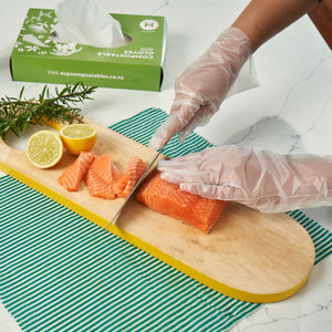 Compostable Gloves. Great for food prep in the business or home. Also a good alternative to plastic gloves for cleaners. This picture is of the gloves being used during food prep in the kitchen. .