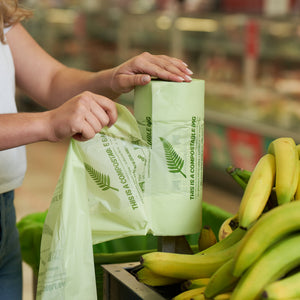 Home Compostable Produce Barrier Bags by Love Our Land. Perfect for carrying your fruit and veggies home from the supermarket. This is a picture of the roll being used in a supermarket.