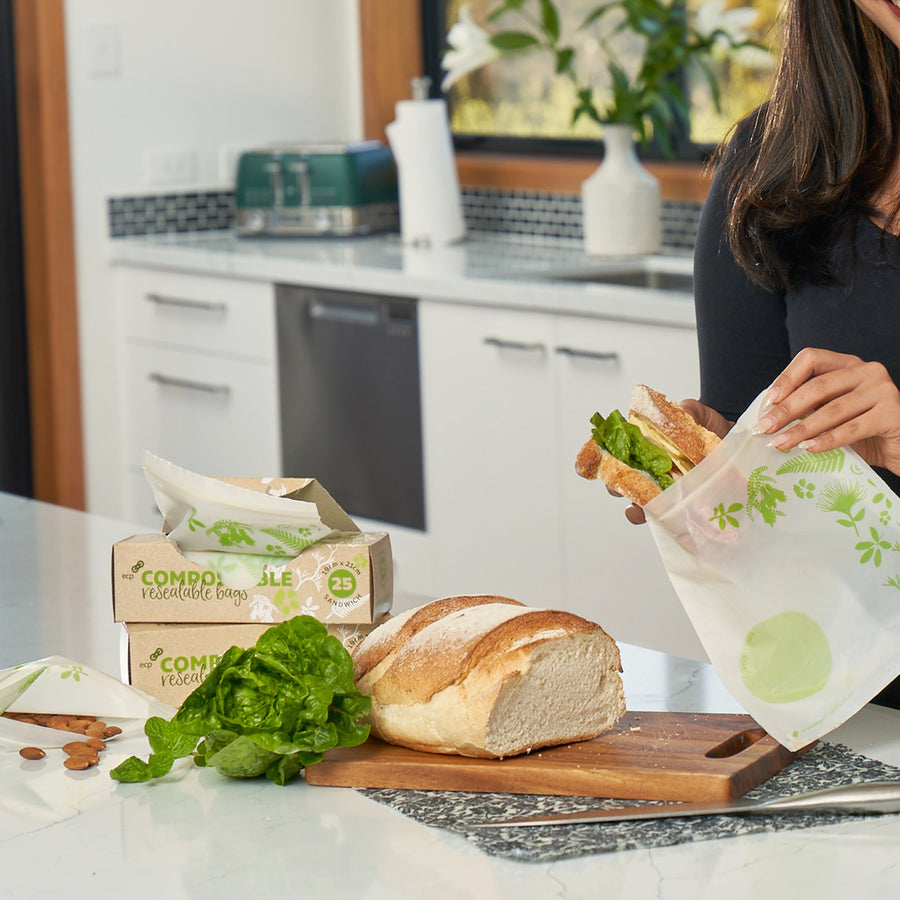 Compostable Zip Lock bags. Great for sandwiches and snacks on the go. These are certified Home Compostable. Picture of compostable zip lock bags in use in the kitchen.