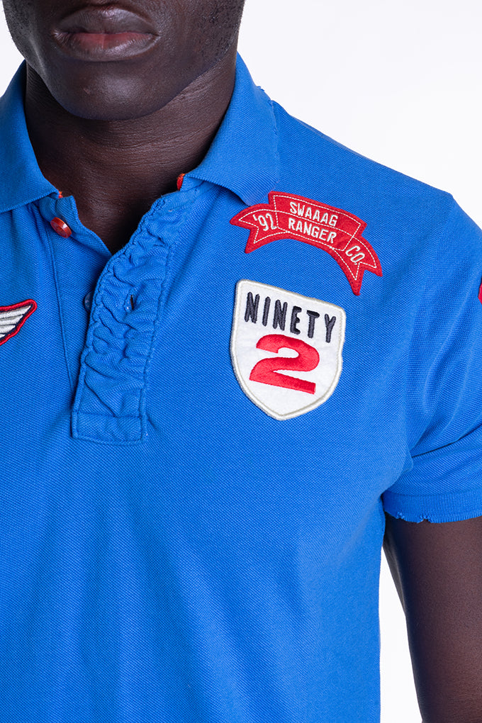 BADGE POLO IN SKY BLUE