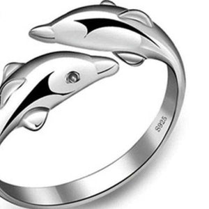 DOLPHIN RING - 64 Corp