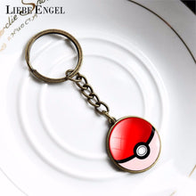 Load image into Gallery viewer, LIEBE ENGEL Fashion Cartoon Keychain Jewelry Bronze Anime Link Chain Keyring Lovely Pokeball Key Chain Women Men Christmas Gift