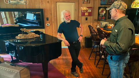 Talking Conservation – and music – with Chuck Leavell (left) in the lodge at CharLane Plantation.