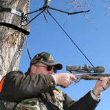 Man in Tree Stand With Harness on, aiming.