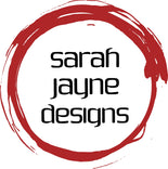 sarah jayne designs logo, name of company surrounded by a red hand painted circle