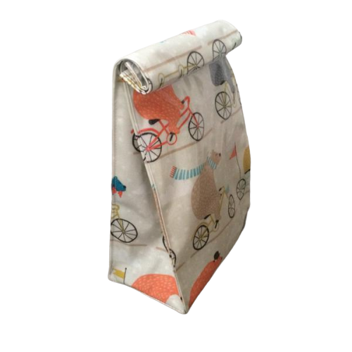 oilcloth fabric roll over top lunch bag featuring bears on bikes