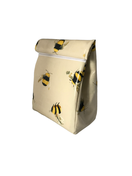 oilcloth fabric roll over top lunch bag featuring honey bees on a natural colour background
