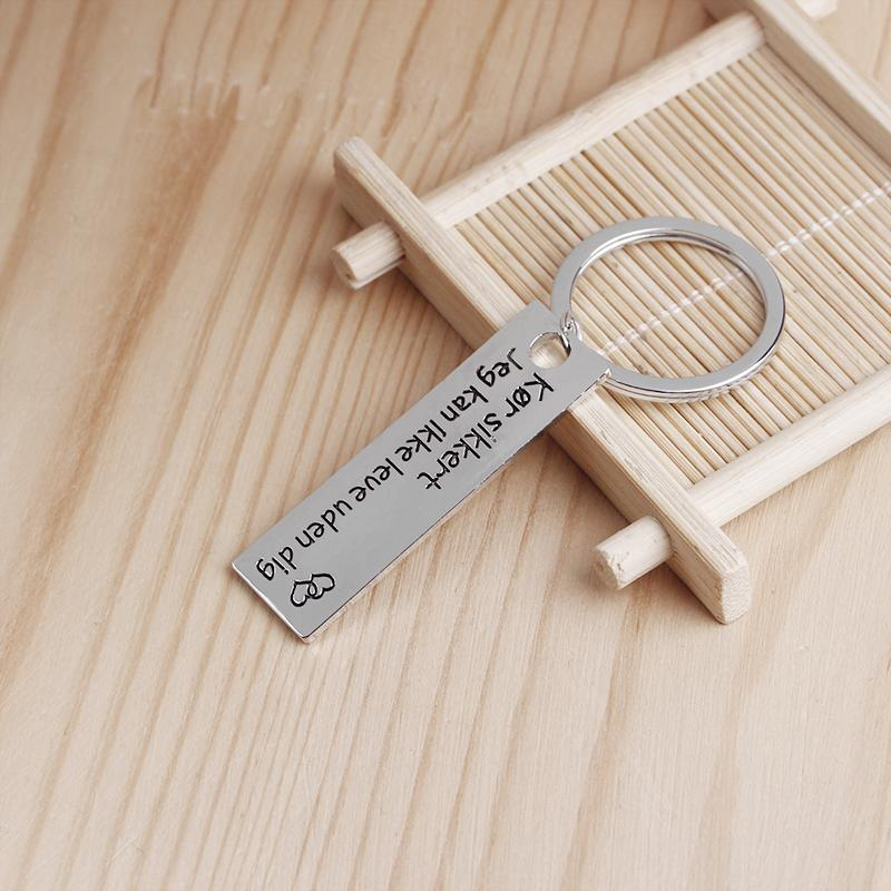 Danish text keyring pendant drive safety