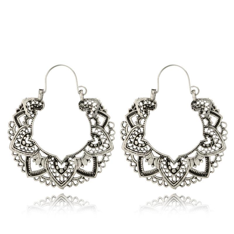 Ethnic carving earrings