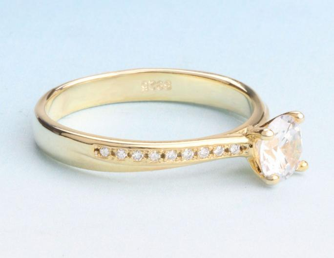 Simple creative female ring four-claw single diamond inlaid zircon gold-plated small simulation diamond ring