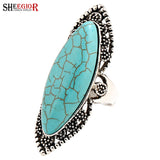 SHEEGIOR Vintage Ethnic Long Rings for Women Accessories Boho Silver Hollow Pattern Ellipse Turquoises Ring Mens Fashion Jewelry