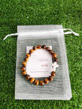 Load image into Gallery viewer, Tiger Eye Protection Bracelet with White Howlite Cross Charm