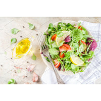 Spring mix salad with cucumbers, cherry tomatoes and  avocado