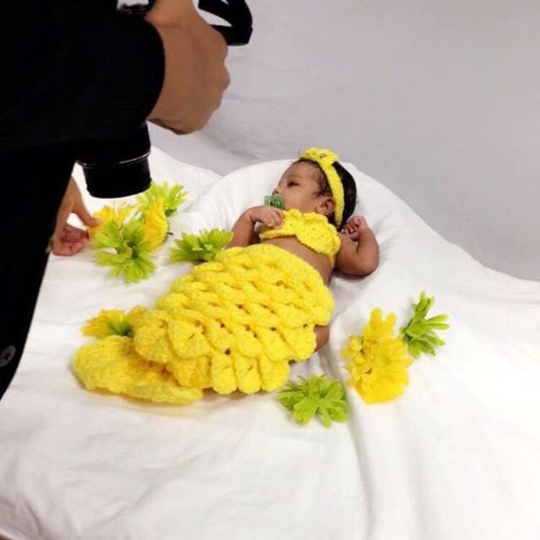 Baby with a yellow crochet mermaid tail
