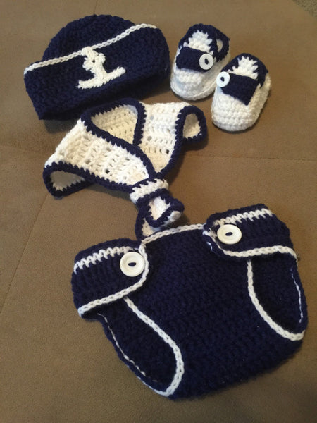 A crochet navy and white sailor outfit