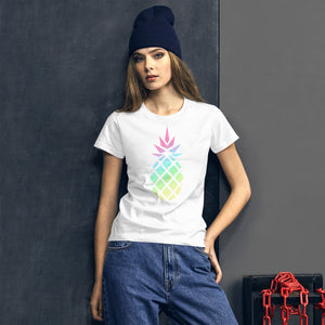 Lifestyle picture of a woman wearing a white women's t-shirt with a big gradient pastel rainbow pineapple graphic.