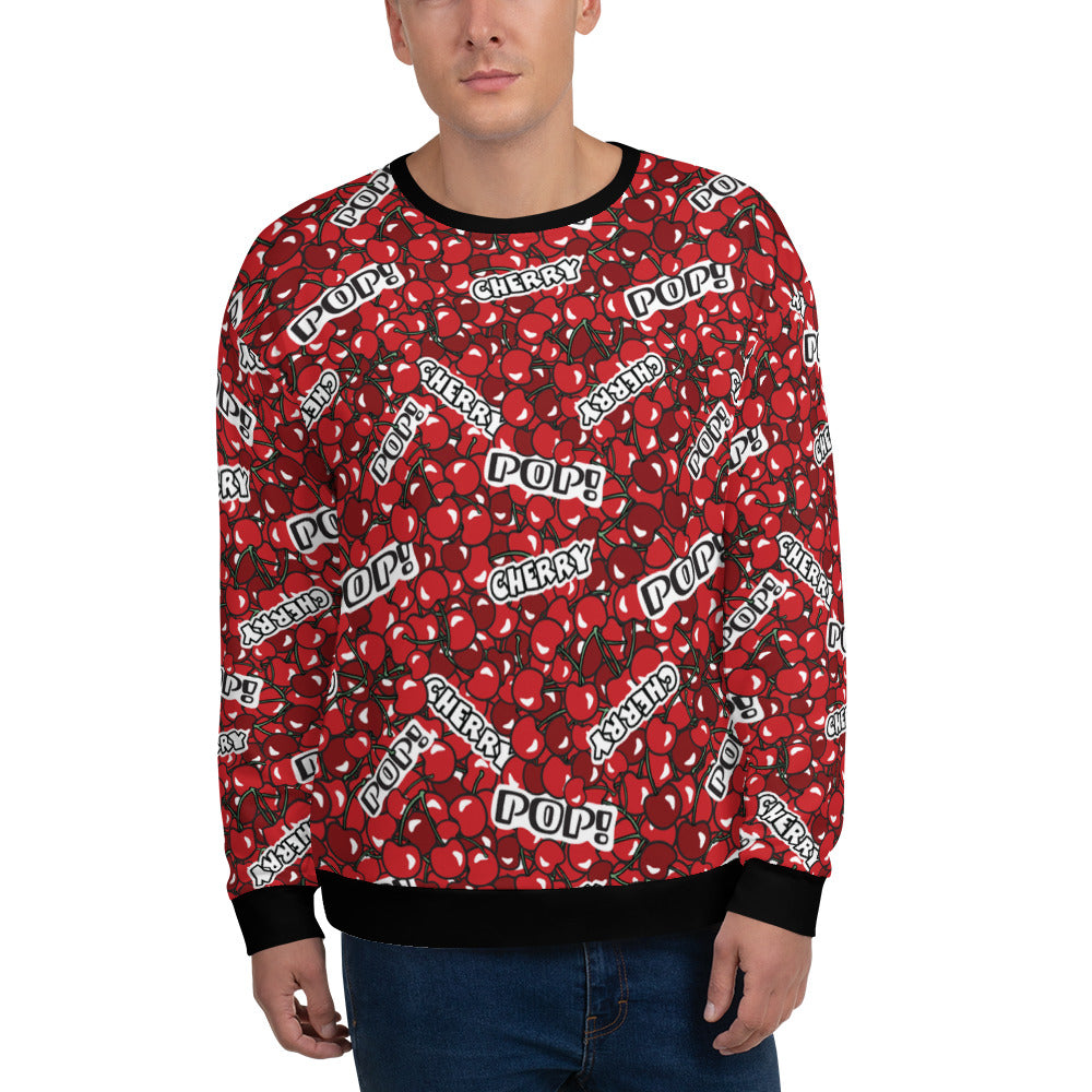 Man wearing a red sweatshirt with a cherry pattern and with the text