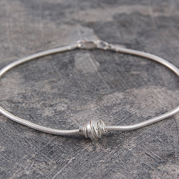 Coiled Silver Charm Bracelet