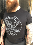 The Rockwell Barbell grey circle logo with eagle on front of black shirt.