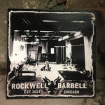 Square sticker with a black and white image of the original Rockwell Barbell gym.