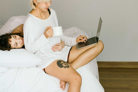 Women on bed with laptop