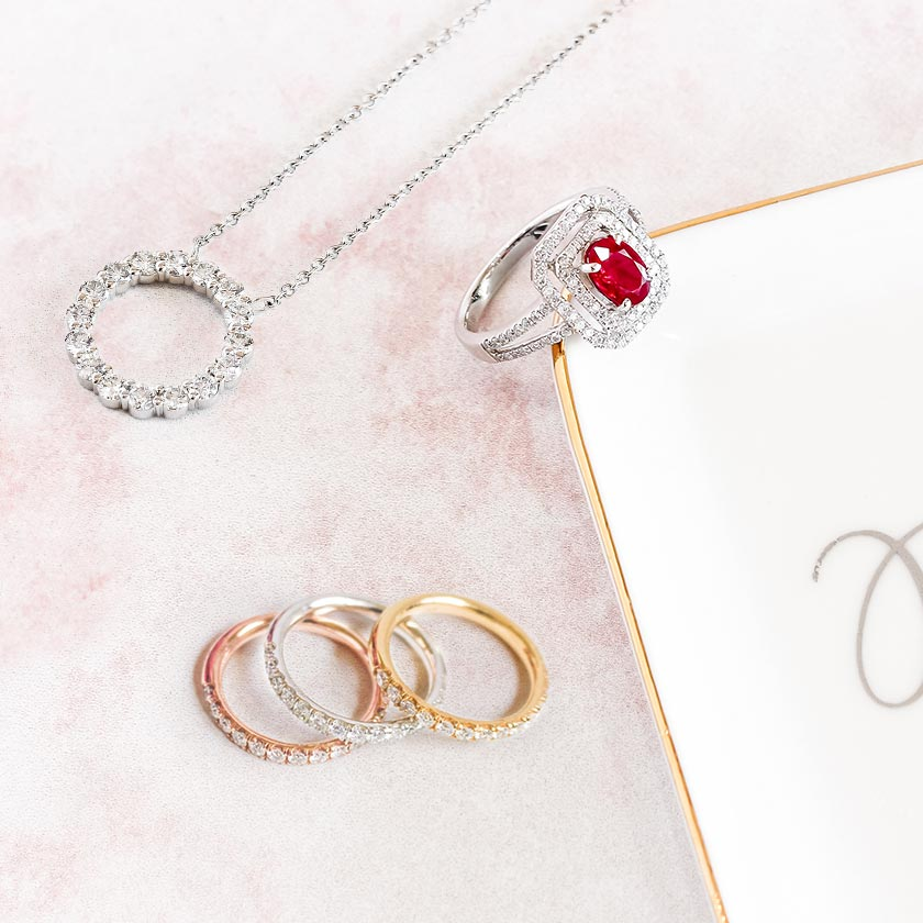 Diamond circle necklace with ruby ring and wedding bands