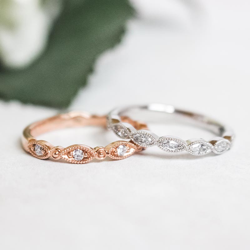 rose and white gold diamond marquise wedding bands