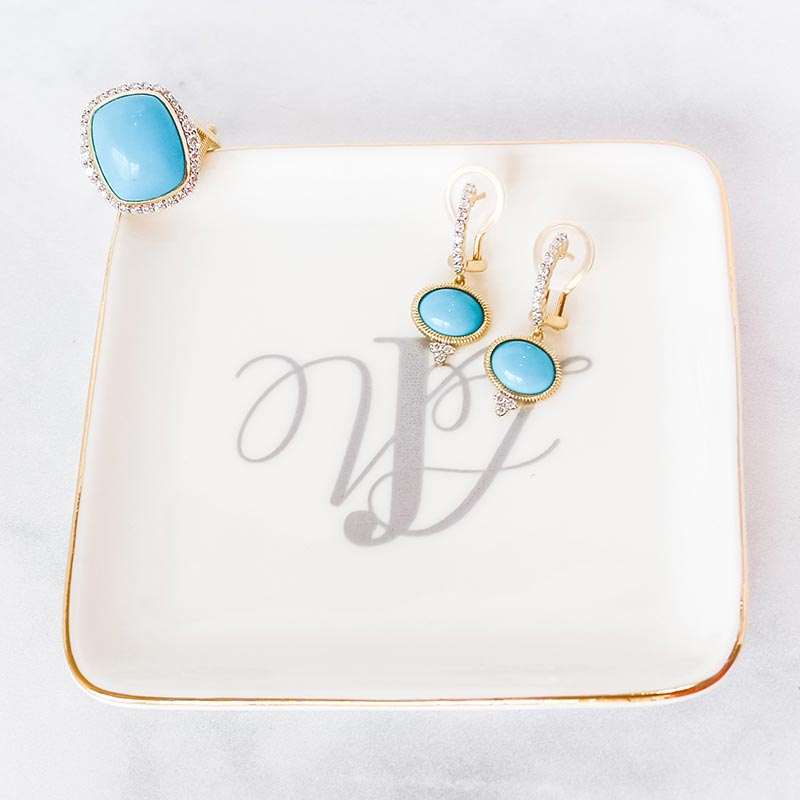 Turquoise diamond earrings and ring on jewelry dish