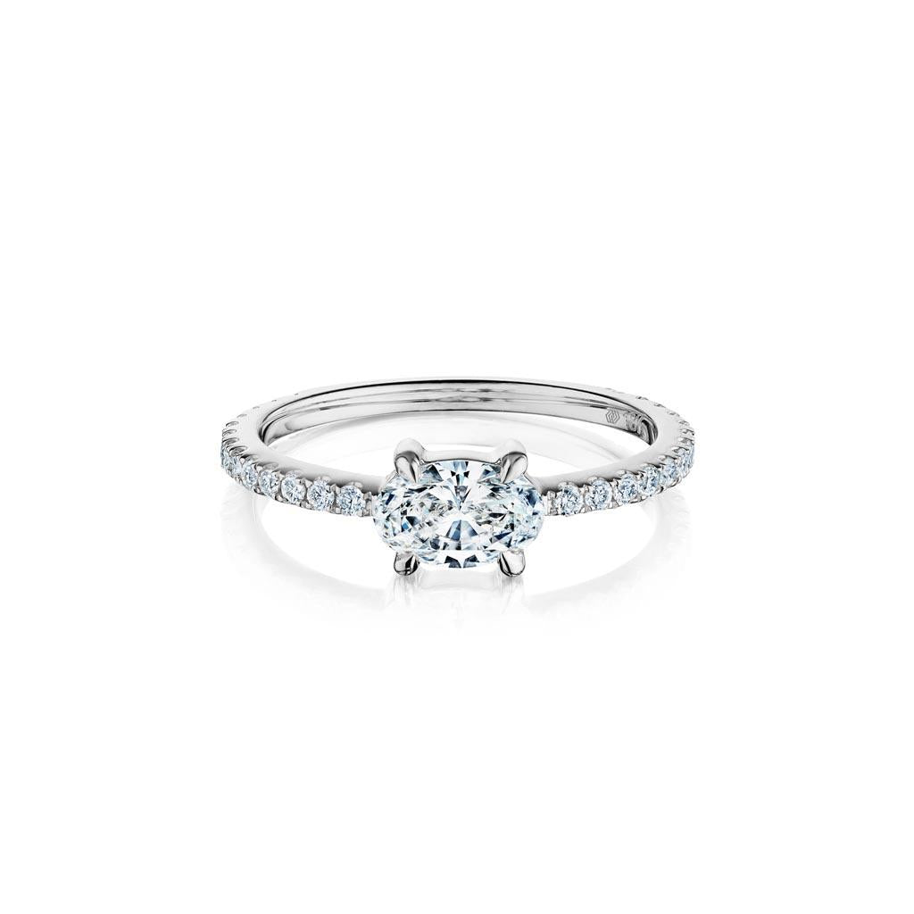 Oval diamond east west solitaire ring