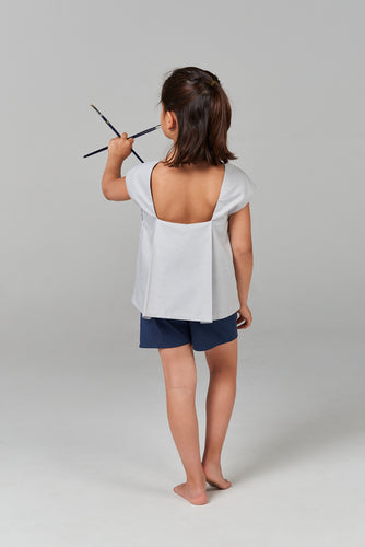 Blouse with back pleat.