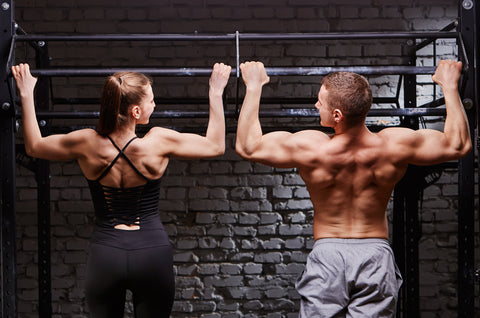 couple doing pullups to increase strength