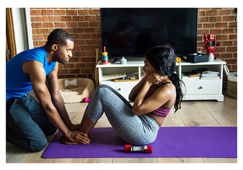 couple exercising at home with yoga mat and dumbbells romantic workout ideas for couples