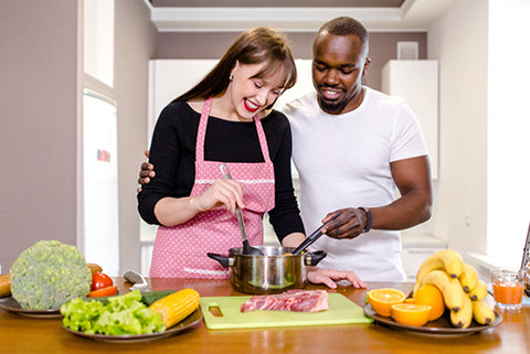happy couple cooking together meal prep meal planning