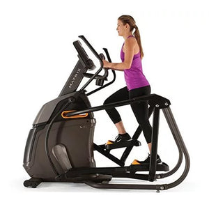 Woman Running on Matrix A30 Ascent Trainer Elliptical side view