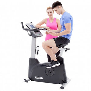 Spirit XBU55 Upright Bike side with two models app for exercise bike