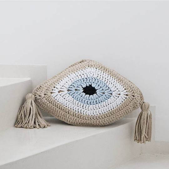 crochet evil eye pillow in lurex gold