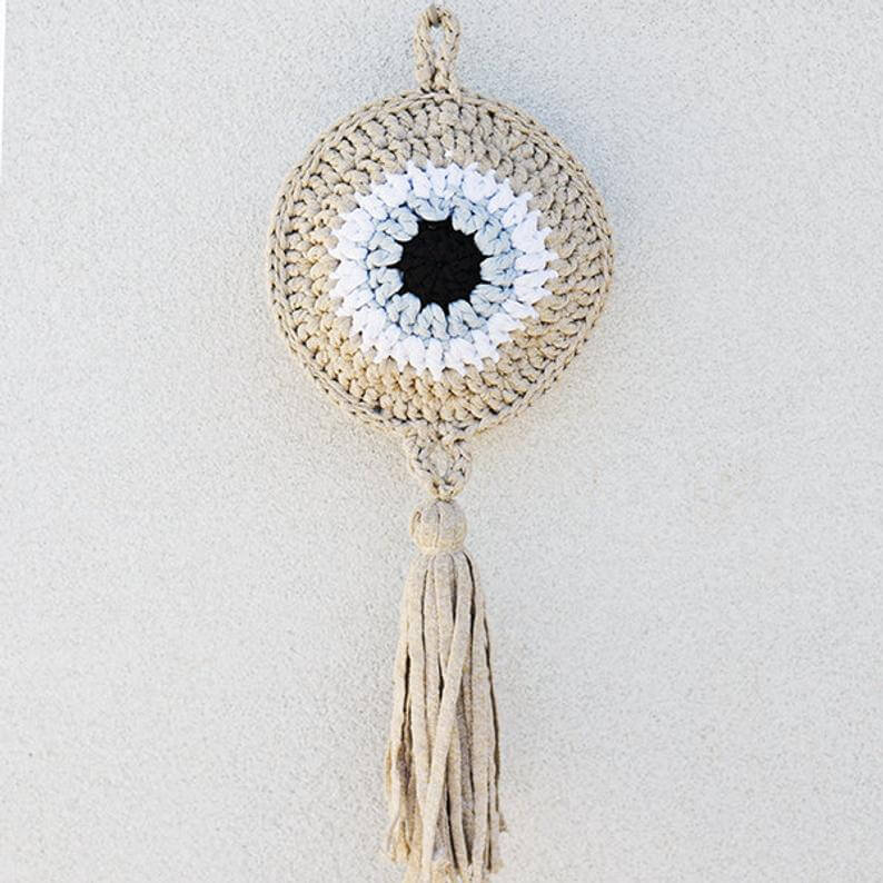 evil eye wall hanging gold