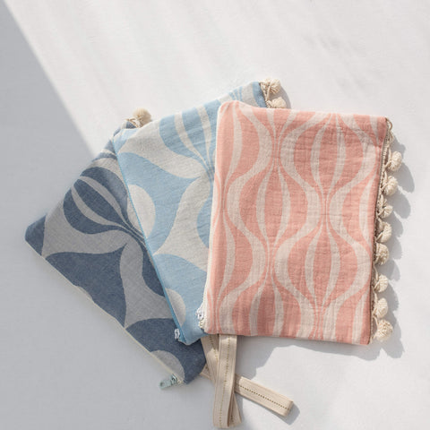 Pouch with pompoms