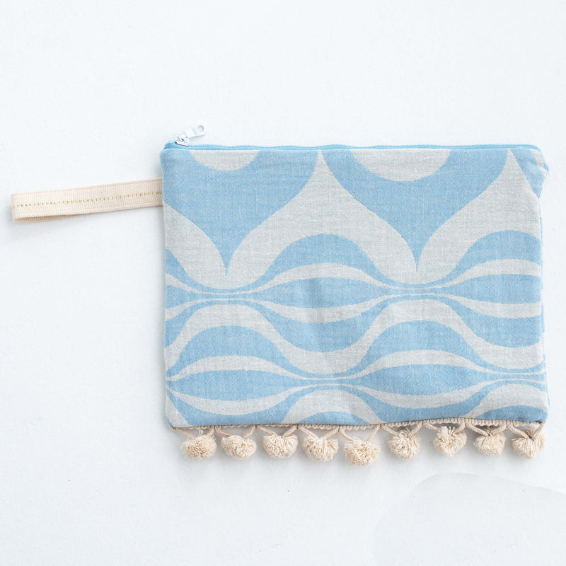 zip pouch with pompoms