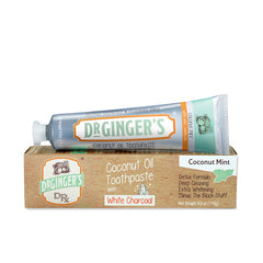 Dr. Ginger's White Charcoal Toothpaste, Tube and Box Laid Horizontally.