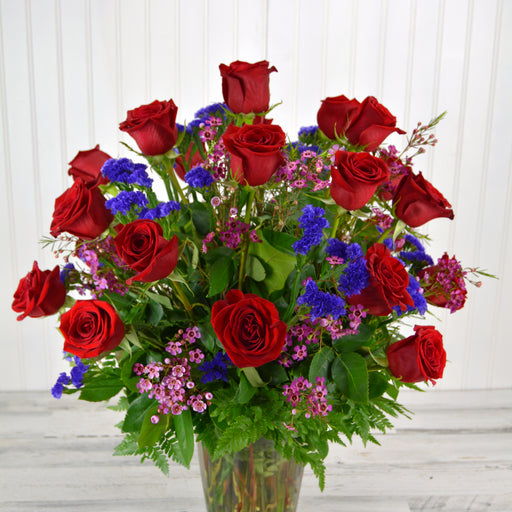 Two Dozen Long Stem Red Roses with Filler in a Vase