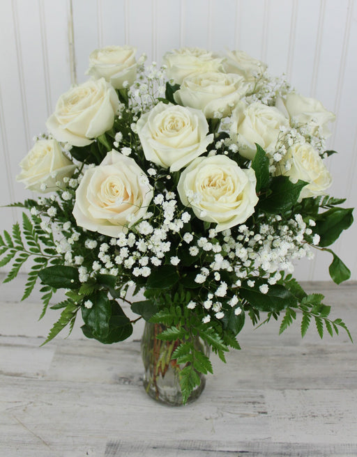 One Dozen White Roses with Baby's Breath in a vase