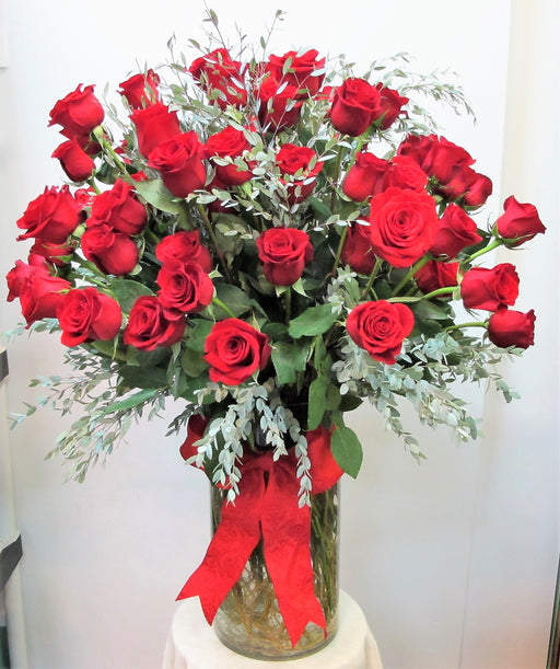 Three Dozen Long Stem Roses with foliage in a vase- Overflow of Roses